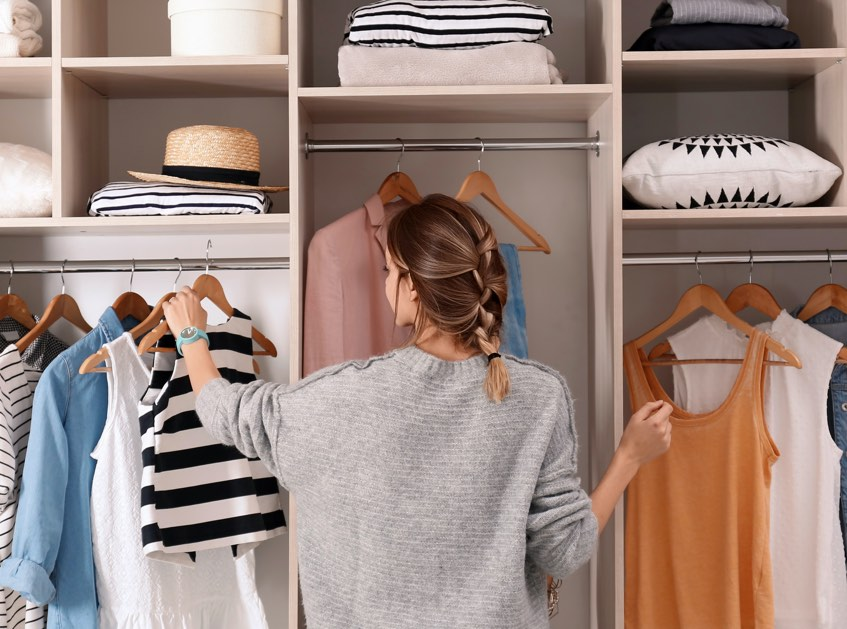 Woman in walk in closet | Top Shelf Closets